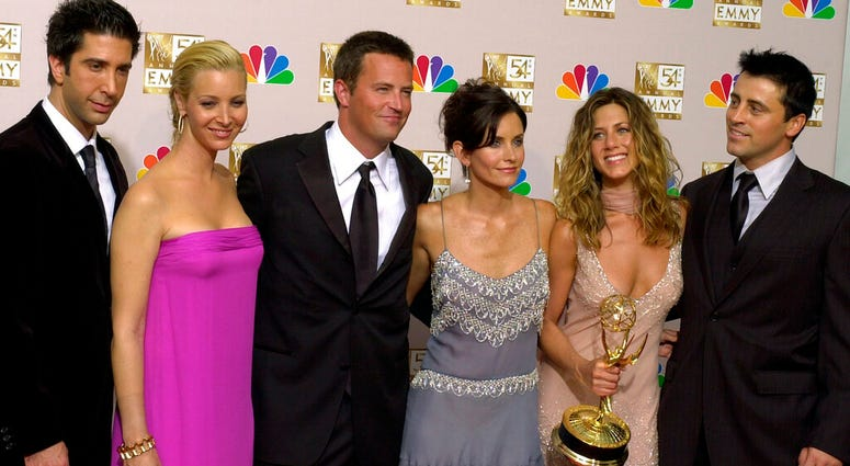 """FILE - In this Sept. 22, 2002 file photo, the stars of """"Friends,"""" from left, David Schwimmer, Lisa Kudrow, Matthew Perry, Courteney Cox Arquette, Jennifer Aniston and Matt LeBlanc pose with the award for outstanding comedy series at the Emmy awards."""