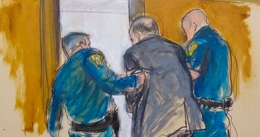 In this courtroom sketch, Harvey Weinstein, center, is led out of Manhattan Supreme Court by court officers after a jury convicted him of rape and sexual assault, Monday, Feb. 24, 2020 in New York.