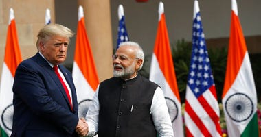 U.S. President Donald Trump and Indian Prime Minister Narendra Modi shake hands before their meeting at Hyderabad House in New Delhi, India, Tuesday, Feb. 25, 2020.