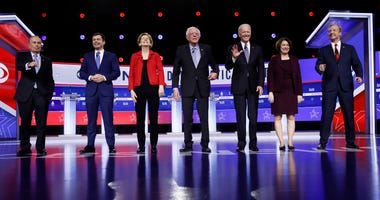 From left: Democratic presidential candidates Mike Bloomberg, Pete Buttigieg, Elizabeth Warren, Bernie Sanders, Joe Biden, Amy Klobuchar and Tom Steyer stand on stage before a Democratic presidential primary debate, Tuesday, Feb. 25, 2020.