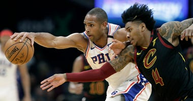Philadelphia 76ers' Al Horford, left, and Cleveland Cavaliers' Kevin Porter Jr. battle for a loose ball in the first half of an NBA basketball game, Wednesday, Feb. 26, 2020, in Cleveland.