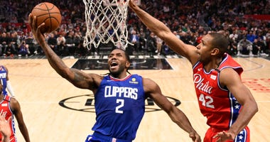 Los Angeles Clippers forward Kawhi Leonard, left, shoots as Philadelphia 76ers forward Al Horford defends during the second half of an NBA basketball game Sunday, March 1, 2020, in Los Angeles. The Clippers won 136-130.