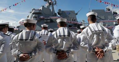 Sailors stand during a commissioning ceremony for the U.S. Navy guided missile destroyer USS Paul Ignatius, at Port Everglades in Fort Lauderdale, Fla., July 27, 2019.