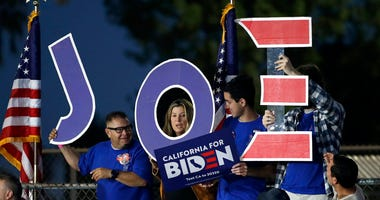 Supporters hold a sign before a campaign rally for Democratic presidential candidate former Vice President Joe Biden on Tuesday, March 3, 2020, in Los Angeles.