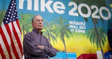 In this March 3, 2020 photo, Democratic presidential candidate former New York City Mayor Mike Bloomberg waits to speak at a news conference, in the Little Havana neighborhood, in Miami.
