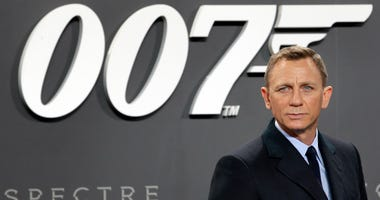 Actor Daniel Craig poses for the media as he arrives for the German premiere of the James Bond movie 'Spectre' in Berlin, Germany, Oct. 28, 2015.