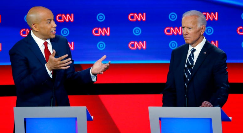 Sen. Cory Booker, D-N.J., gestures to former Vice President Joe Biden during the second of two Democratic presidential primary debates hosted by CNN in the Fox Theatre in Detroit, July 31, 2019.