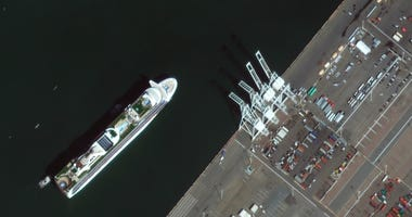 In this satellite image provided by Maxar Technologies, the Grand Princess cruise ship is seen as it was preparing to dock at the Port of Oakland in Oakland, Calif., Monday, March 9, 2020.