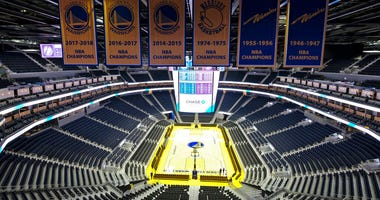 FILE - In this Aug. 26, 2019, file photo, the Golden State Warriors championship banners hang above the seating and basketball court at the Chase Center in San Francisco.
