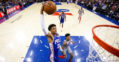 Philadelphia 76ers' Matisse Thybulle (22) goes up for a dunk past Detroit Pistons' Christian Wood (35) during the first half of an NBA basketball game, Wednesday, March 11, 2020, in Philadelphia.