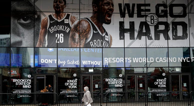 A pedestrian passes an entrance to the Barclays Center in the Brooklyn borough of New York.