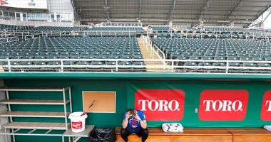 Minnesota Twins catcher Mitch Garver talks on his phone in an empty Hammond Stadium.