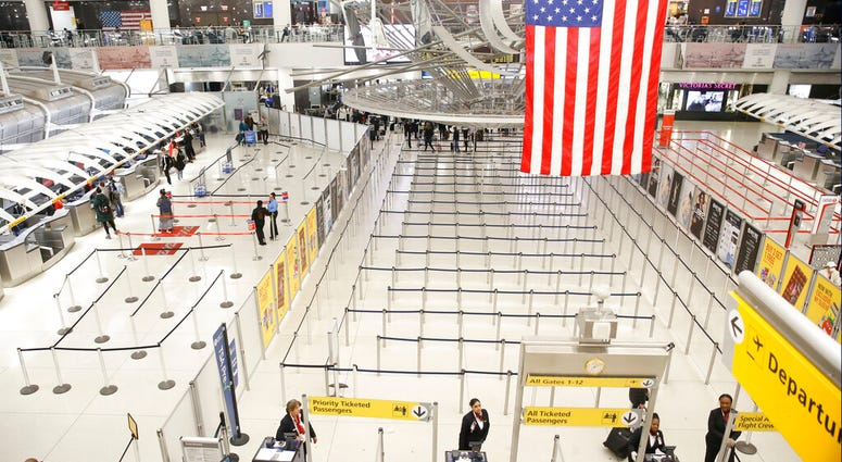 The area for TSA screening of travelers at JFK airport's Terminal 1 is relatively empty, Friday, March 13, 2020, in New York.