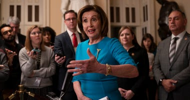 Speaker of the House Nancy Pelosi, D-Calif., makes a statement ahead of a planned late-night vote on the coronavirus aid package deal at the Capitol in Washington, Friday, March 13, 2020.