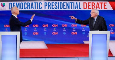Former Vice President Joe Biden, left, and Sen. Bernie Sanders, I-Vt., right, participate in a Democratic presidential primary debate at CNN Studios in Washington, Sunday, March 15, 2020.