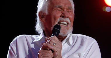 In this June 9, 2012, file photo, Kenny Rogers performs at the 2012 CMA Music Festival in Nashville, Tenn.
