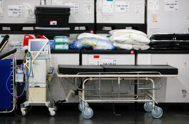 This Monday, March 23, 2020, file photo shows medical supplies and a stretcher displayed before a news conference at the Jacob Javits Center in New York.