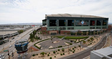 Traffic is extremely light in front of Chase Field, Thursday, March 26, 2020, in Phoenix.