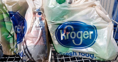 Bagged purchases from the Kroger grocery store in Flowood, Miss., sit inside this shopping cart.