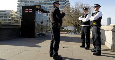 Police officers stand outside St Thomas' Hospital in central London as British Prime Minister Boris Johnson was moved to intensive care after his coronavirus symptoms worsened in London, Tuesday, April 7, 2020.