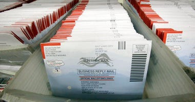 In this Nov. 1, 2016, file photo, mail-in ballots for the 2016 General Election are shown at the elections ballot center at the Salt Lake County Government Center, in Salt Lake City.