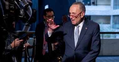 Senate Minority Leader Sen. Chuck Schumer of N.Y., speaks to reporters on March 20, 2020, as he arrives for a meeting to discuss the coronavirus relief bill on Capitol Hill Washington.