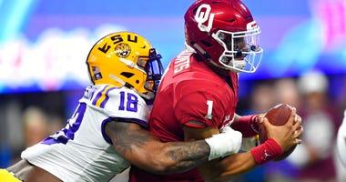 LSU linebacker K'Lavon Chaisson (18) sacks Oklahoma quarterback Jalen Hurts (1).