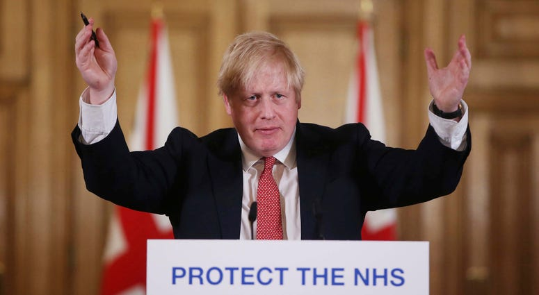 In this Sunday March 22, 2020 file photo British Prime Minister Boris Johnson gestures during his daily COVID 19 coronavirus press briefing to announce new measures to limit the spread of the virus.