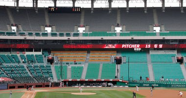 Stadium seats are empty as a part of precaution against the new coronavirus during a baseball game between Hanwha Eagles and SK Wyverns in Incheon, South Korea, Tuesday, May 5, 2020.