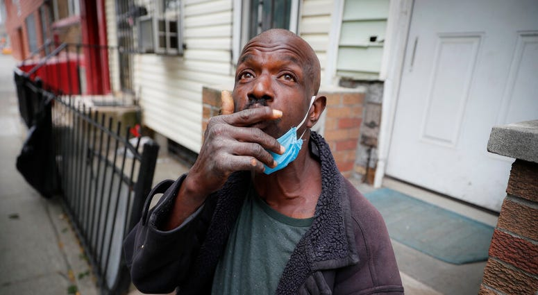 Aubrey, 57, describes the loneliness brought on by social distancing protocols after receiving a dose of antipsychotic medication to treat his schizophrenia, Wednesday, May 6, 2020, in the Brooklyn borough of New York.