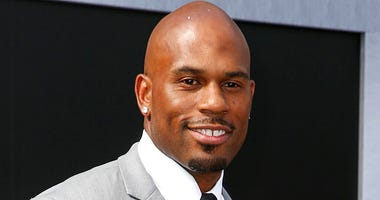 """In this June 28, 2015, file photo, WWE wrestler Shad Gaspard arriving at the Los Angeles premiere of """"Terminator Genisys"""" at the Dolby Theatre in Los Angeles."""