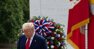 President Donald Trump turns after placing a wreath at the Tomb of the Unknown Soldier in Arlington National Cemetery, in honor of Memorial Day, Monday, May 25, 2020, in Arlington, Va.