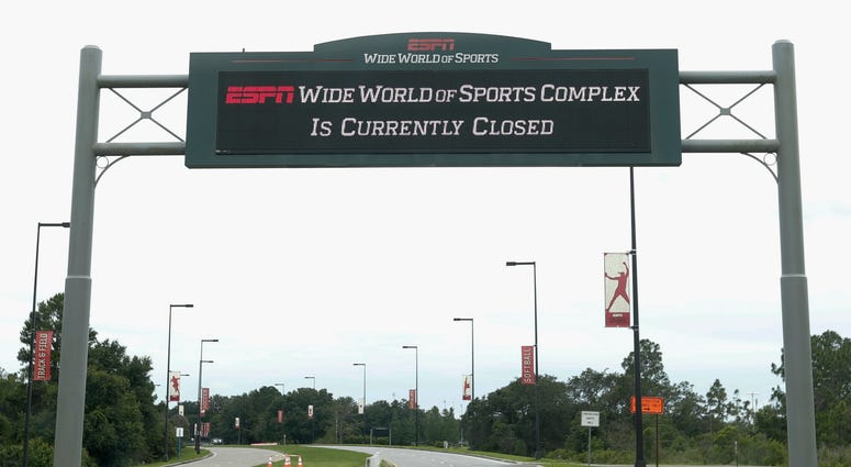 A sign at the entrance to ESPN's Wide World of Sports at Walt Disney World is seen Wednesday, June 3, 2020, in Kissimmee, Fla.