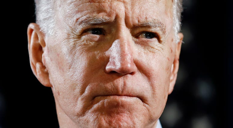 In this March 12, 2020, file photo Democratic presidential candidate former Vice President Joe Biden speaks about the coronavirus in Wilmington, Del. Biden has won the last few delegates he needed to clinch the Democratic nomination for president.