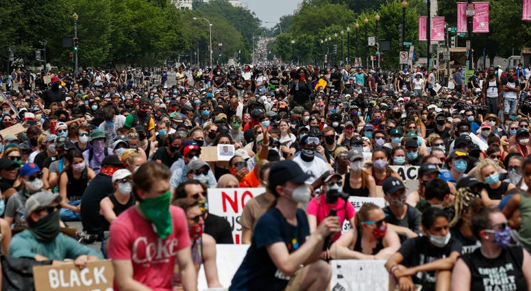 Demonstrators protest Saturday, June 6, 2020, in Washington, over the death of George Floyd, a black man who was in police custody in Minneapolis. Floyd died after being restrained by Minneapolis police officers.