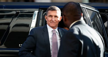 President Donald Trump's former National Security Advisor Michael Flynn arrives at federal court in Washington, Dec. 18, 2018.