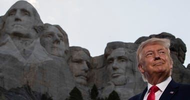 President Donald Trump smiles at Mount Rushmore National Memorial, Friday, July 3, 2020, near Keystone, S.D.
