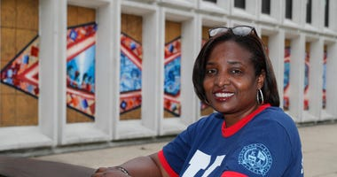 Karen Calloway, principal of Kenwood Academy in Chicago, poses Tuesday, July 28, 2020, for a portrait outside the Hyde Park neighborhood campus.