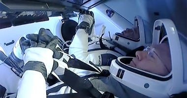 Astronauts Doug Hurley and Bob Behnken prepare to return to earth on a SpaceX capsule, Sunday Aug. 2, 2020.