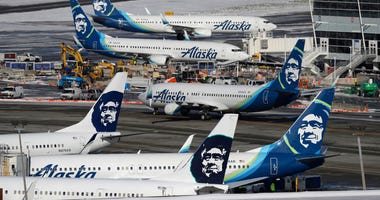 In this Feb. 5, 2019, file photo, Alaska Airlines planes are parked at a gate area at Seattle-Tacoma International Airport in Seattle.
