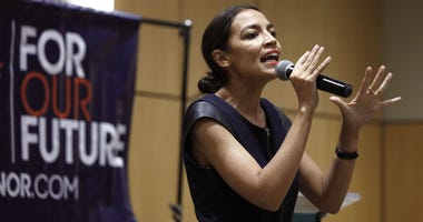 New York Democrat candidate for Congress Alexandria Ocasio-Cortez campaigns for Michigan Democratic gubernatorial candidate Abdul El-Sayed at a rally on the campus of Wayne State University July 28, 2018 in Detroit, Michigan.