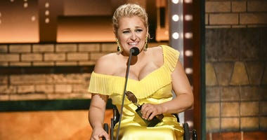 """Ali Stroker accepts the award for best performance by an actress in a featured role in a musical for """"Rodgers & Hammerstein's Oklahoma!""""at the 73rd annual Tony Awards at Radio City Music Hall on Sunday, June 9, 2019, in New York."""