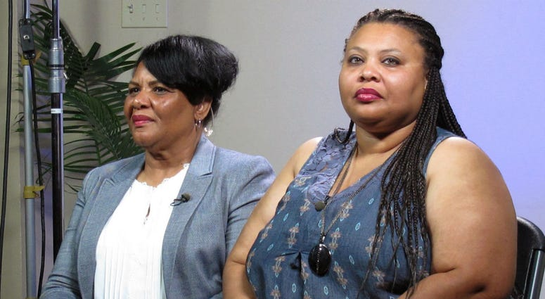 In this June 7, 2018 file photo, Alice Marie Johnson, left, and her daughter Katina Marie Scales wait to start a TV interview on in Memphis, Tenn.