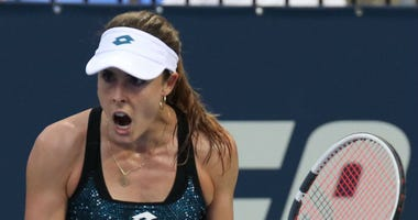 Alize Cornet of France reacts in the match against Tatjana Maria of Germany in the Rogers Cup tennis tournament at IGA Stadium.