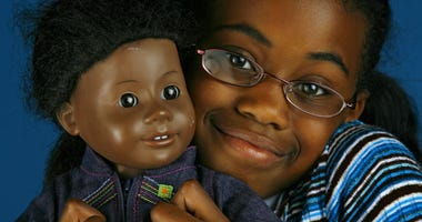 Micah Welch, a fourth-grader from Kansas City, Missouri, pictured April 23, 2007, has cherished her American Girl doll, Addy, for the past four years. The Toy and Miniature Museum currently has an exhibit of American girl dolls on display.