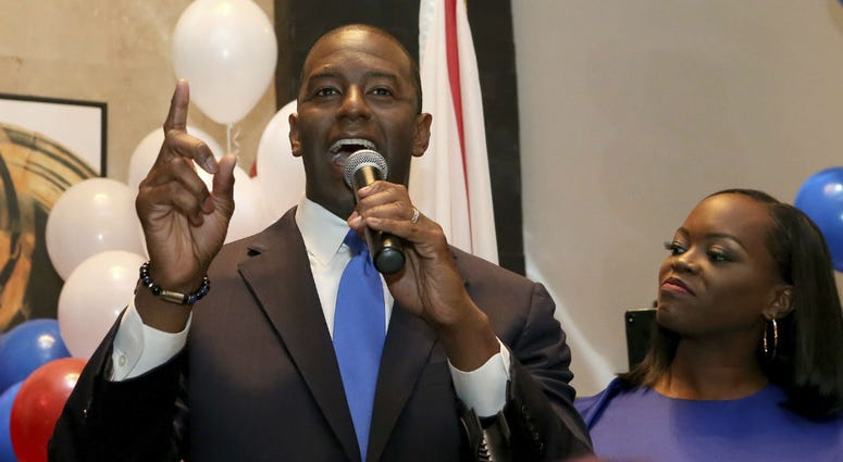 Andrew Gillum with his wife, R. Jai Gillum at his side addresses his supporters after winning the Democrat primary for governor on Tuesday, Aug. 28, 2018, in Tallahassee, Fla.