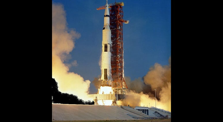 The Apollo 11 Saturn V space vehicle lifts off with Astronauts Neil A. Armstrong, Michael Collins and Edwin E. Aldrin Jr. at 9:32 a.m. EDT July 16, 1969, from Kennedy Space Center's Launch Complex 39A