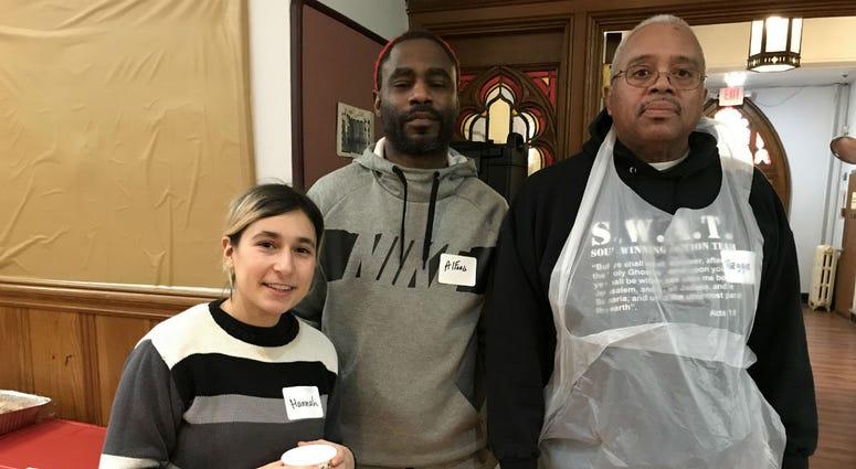 Volunteers serve Christmas breakfast at Arch Street United Methodist Church.