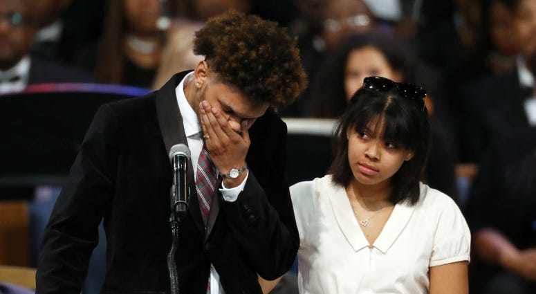 Jordan Franklin, left, pauses alongside his sister Victorie Franklin while speaking about their grandmother, Aretha Franklin, during the funeral service for the legendary singer at Greater Grace Temple, Friday, Aug. 31, 2018, in Detroit.