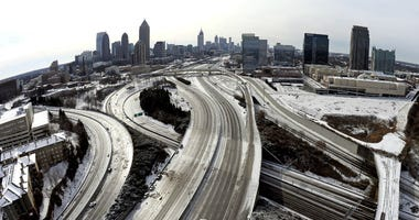 The ice-covered interstate system shows the remnants of a 2014 winter snow storm in Atlanta.